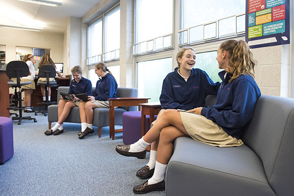 Students sitting in library.